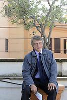 Roma 11 Ottobre 2012.via Sant'Andrea delle Fratte .David Sassoli candidato alle primarie per l'elezione del sindaco di Roma nel terrazzo sede del Partito Democratico seduto sotto un ulivo.