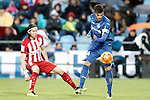 Getafe's Pedro Leon (r) and Atletico de Madrid's Filipe Luis during La Liga match. February 14,2016. (ALTERPHOTOS/Acero)