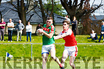 Tom Leo O'Sullivan Dingle tackles Kevin McCarthy Kilcummin during their SFC relegation play off in Killorglin on Sunday