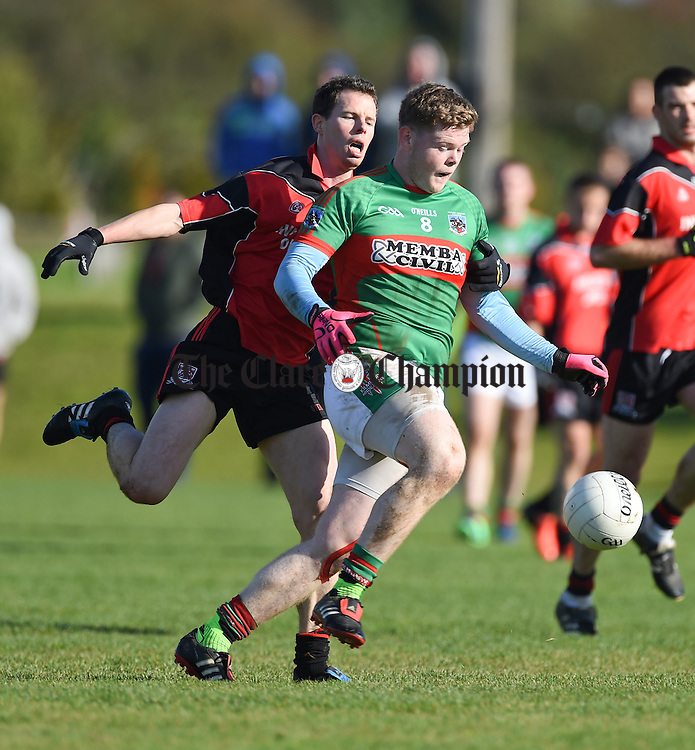 Kevin Harnett of Meelick  in action against Keith Sexton of Kilmurry Ibrickane during their Junior A  county final at Gurteen. Photograph by John Kelly.