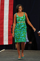 MIAMI LAKES, FL - JULY 10:  First lady Michelle Obama speaks to supporters and volunteers at the Barbara Goleman High School on July 10, 2012 in Miami Lakes, Florida. © mpi04/MediaPunch Inc