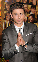 """HOLLYWOOD, CA - DECEMBER 05: Zac Efron arrives at the Los Angeles premiere of """"New Year's Eve"""" at Grauman's Chinese Theatre on December 5, 2011 in Hollywood, California."""