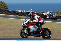 Max Neukirchner (GER) riding the Ducati Panigale 1199R (27) of the MR-Racing team exits turn 10 during a practise session on day two of round one of the 2013 FIM World Superbike Championship at Phillip Island, Australia. rounds turn 11 during a practise session on day two of round one of the 2013 FIM World Superbike Championship at Phillip Island, Australia.