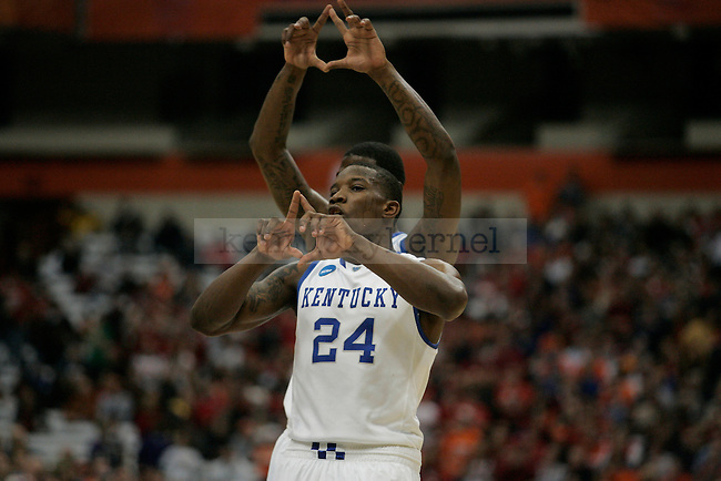 UK's Eric Bledsoe and DeAndre Liggins call a play against Cornell in the Carrier Dome on Thursday, March 25, 2010. Photo by Britney McIntosh | Staff