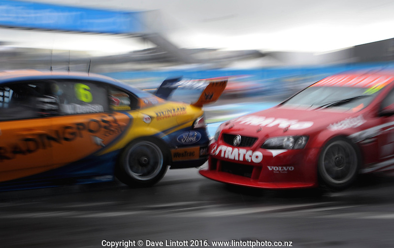 David Reynolds pressures Will Davison during race one. V8 Supercars - ITM 400 day two at Hamilton Street Circuit, Hamilton, New Zealand on Saturday, 16 April 2011. Photo: Dave Lintott / lintottphoto.co.nz