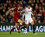 Jordan Henderson of Liverpool tackles Joaquin Correa of Sevilla during the Champions League Group E match at the Anfield Stadium, Liverpool. Picture date 13th September 2017. Picture credit should read: Simon Bellis/Sportimage