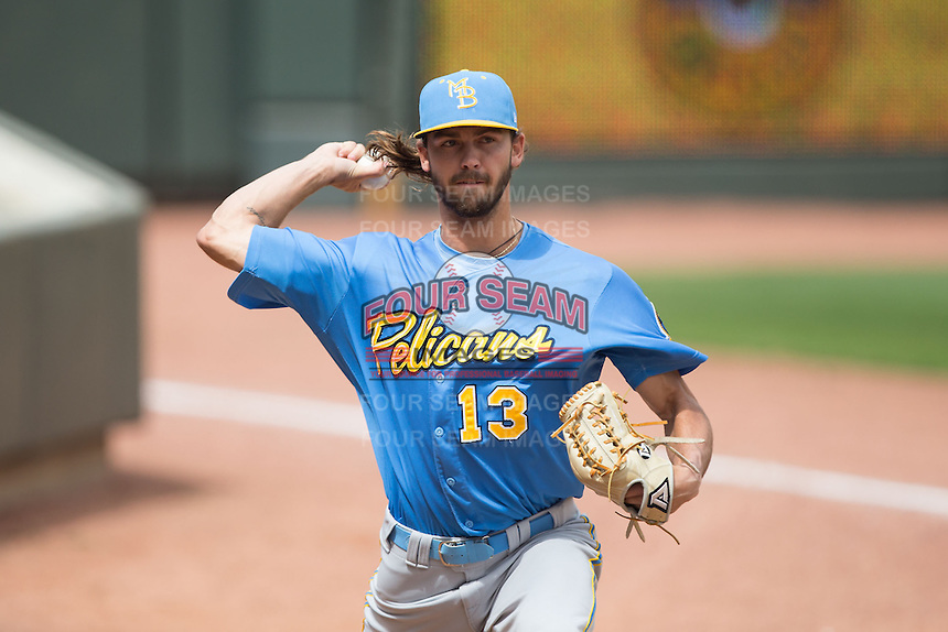 Myrtle Beach Pelicans relief pitcher Tayler Scott (13) warms up in the bullpen during the game against the Winston-Salem Dash at BB&T Ballpark on May 10, 2015 in Winston-Salem, North Carolina.  The Pelicans defeated the Dash 4-3.  (Brian Westerholt/Four Seam Images)