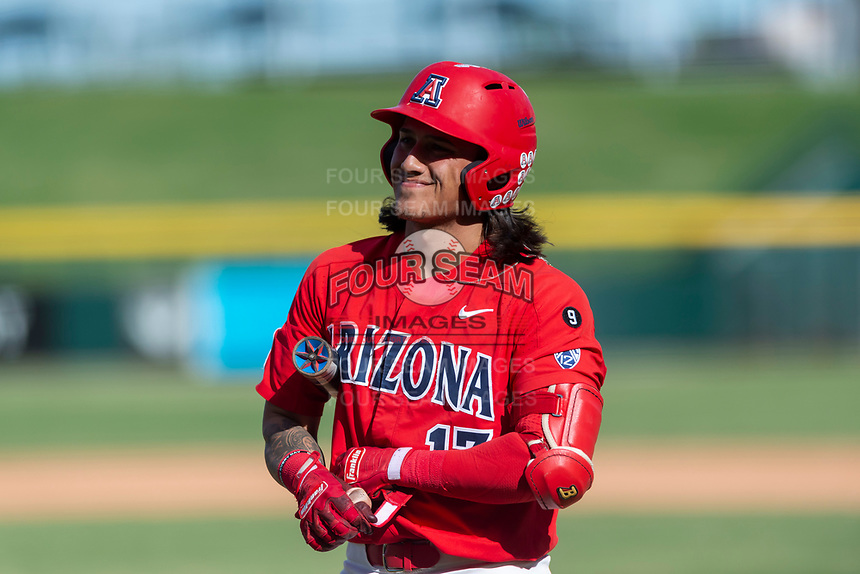 Arizona Wildcats third baseman Nick Quintana (13) adjusts his batting gloves during an NCAA exhibition game against Cal State Fullerton at Sloan Park on October 28, 2018 in Mesa, Arizona. (Zachary Lucy/Four Seam Images)