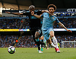 Allan Nyom of West Bromwich Albion in action with Leroy Sane of Manchester City during the English Premier League match at the Etihad Stadium, Manchester. Picture date: May 16th 2017. Pic credit should read: Simon Bellis/Sportimage