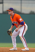 First baseman Jon McGibbon (12) of the Clemson Tigers in a game against the Furman Paladins on Wednesday, May 8, 2013, at Fluor Field at the West End in Greenville, South Carolina. (Tom Priddy/Four Seam Images)