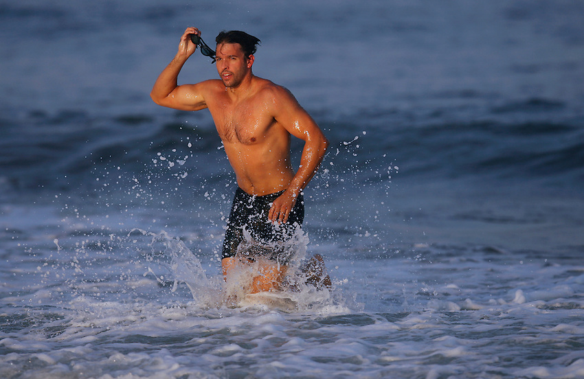 Belmar lifeguard Ian King emerges from the surf during the 600-Meter Swim event at the First Annual Asbury Park Beach Bar Lifeguard Competition held at the 3rd Avenue beach in Asbury Park.  ASBURY PARK, NJ  8/4/07  8:21:47 PM  PHOTO BY ANDREW MILLS
