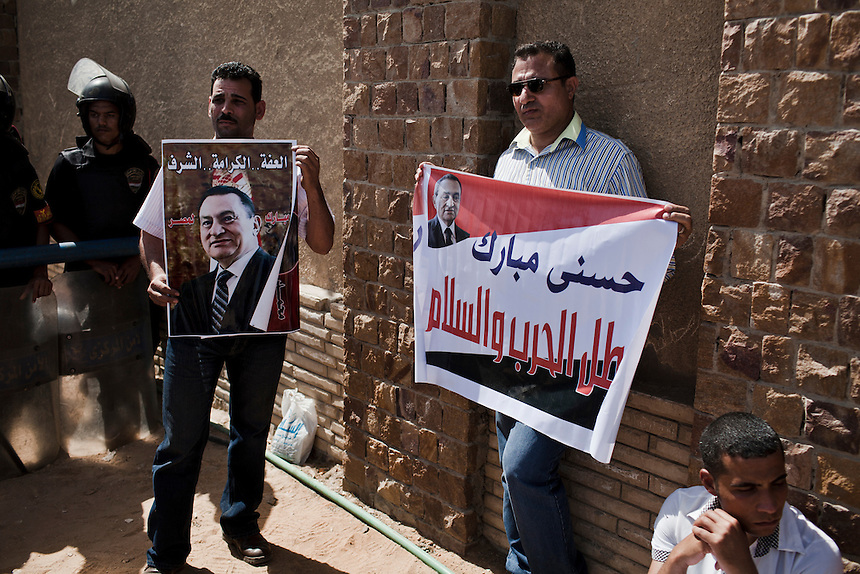 Supporters of former Egyptian President, Hosni Mubarak, wait to hear the verdict in his trial in front of the Cairo Police Academy, Egypt, June 2, 2012. Photo: ED GILES.
