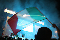 Italian fans wave national flags while they celebrate their victory in the 2006 FIFA World Cup final match while watching on large outdoor public screens at the FIFA World Cup Fan Fest in Tiergarten park in Berlin. The game was held at the Olympic Stadium in Berlin, Germany on Sunday July 9th, 2006. Italy won on penalty-kicks, 5-3, over France after the match ended up in a draw in regulation and extra time