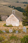 Historic old wooden Catholic Church at the cemetery, headstones, Creede, Colo.