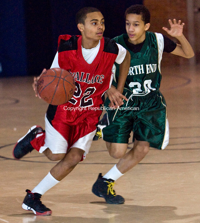 WATERBURY, CT - 08 FEBRUARY 2009 -020809JT02-<br /> Wallace's Gabe Pulliman dribbles past North End's Terrance Thompson during Sunday's middle school basketball jamboree at the Armory in Waterbury. Wallace won, 64-49.<br /> Josalee Thrift / Republican-American