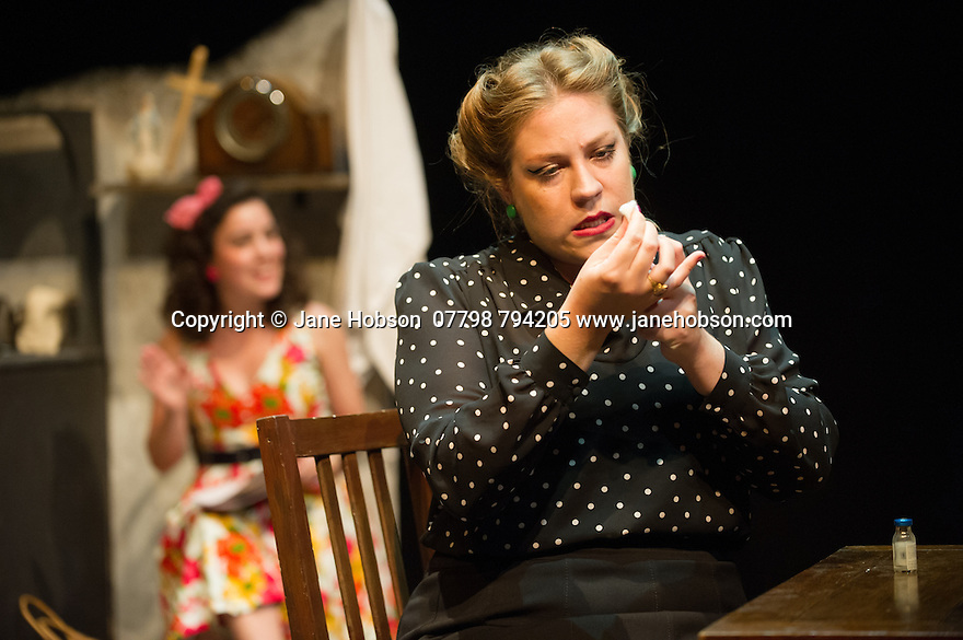 London, UK. 18.07.2014. Mountview Academy of Theatre Arts presents SATURDAY, SUNDAY, MONDAY by Eduardo de Filippo, the English adaptation by Keith Waterhouse & Willis Hall, directed by Michael Howcroft, at the Unicorn Theatre, as part of the Postgraduate Season 2014. Picture shows: Sophie Napleton (Aunt Meme) and Amy Tobias (background - Guillianella). Photograph © Jane Hobson.