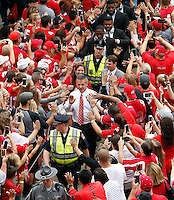 Ohio State Buckeyes head coach Urban Meyer and the Buckeyes walk into Ohio Stadium before their game against Northern Illinois Huskies at Ohio Stadium on September 19, 2015.  (Dispatch photo by Kyle Robertson)