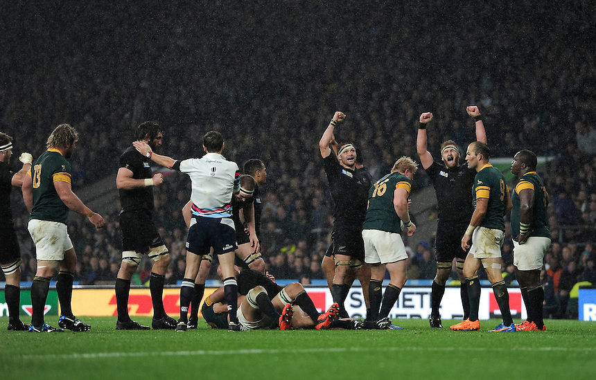 Referee J&eacute;r&ocirc;me Garc&egrave;s blows the final whistle, New Zealand's Richie McCaw and Kieran Read celebrate their 20-18 victory<br /> <br /> Photographer Ashley Western/CameraSport<br /> <br /> Rugby Union - Guinness PRO12 - Semi Final - South Africa v New Zealand - Saturday 24th October 2015 - Twickenham, London <br /> <br /> &copy; CameraSport - 43 Linden Ave. Countesthorpe. Leicester. England. LE8 5PG - Tel: +44 (0) 116 277 4147 - admin@camerasport.com - www.camerasport.com
