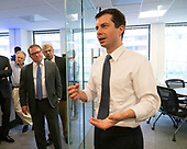Bluelight Founders Steve Rabinowitz and Aaron Keyak listen on as Mayor Pete Buttigieg speaks with leaders of the Jewish community at a communal parlor meeting at the offices of Bluelight Strategies in Washington D.C., U.S. on May 23, 2019.<br /> <br /> Credit: Stefani Reynolds / CNP