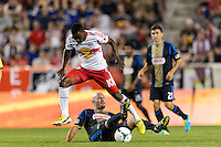 Lloyd Sam (10) of the New York Red Bulls jumps over Conor Casey (6) of the Philadelphia Union. The New York Red Bulls and the Philadelphia Union played to a 0-0 tie during a Major League Soccer (MLS) match at Red Bull Arena in Harrison, NJ, on August 17, 2013.
