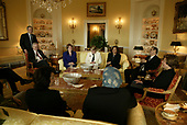 United States President George W. Bush drops a tea hosted by Mrs. Bush for the Iraqi Minister of Education, Dr. Ala'din Alwan, (seated next Mrs. Bush) in the White House Tuesday, January 14, 2004.  Pictured, from left, are: U.S. Ambassador Bob Blackwill; Director of Projects for Mrs. Bush Anne Heiligenstein; Assistant to the President for Domestic Policy Margaret Spellings; Special Assistant to the President Shirring Tahir-Kheli. Pictured in the foreground are Senior American Advisor Leslye Arsht, left, and Dr. Raja Khuzai of the Iraqi Governing Council.<br /> Mandatory Credit: Susan Sterner / White House via CNP