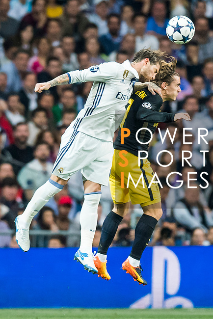 Sergio Ramos (l) of Real Madrid competes for the ball with Antoine Griezmann of Atletico de Madrid during their 2016-17 UEFA Champions League Semifinals 1st leg match between Real Madrid and Atletico de Madrid at the Estadio Santiago Bernabeu on 02 May 2017 in Madrid, Spain. Photo by Diego Gonzalez Souto / Power Sport Images