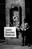 """On April 1st, 1933, the boycott which was announced by the Nationalsocialistic party began.  Placard reads, """"Germans, defend yourselves, do not buy from Jews,"""" at the Jewish Tietz store.  Berlin.  New York Times Paris Bureau Collection.  (USIA)<br /> Exact Date Shot Unknown<br /> NARA FILE #:  306-NT-178018<br /> WAR & CONFLICT BOOK #:  985"""