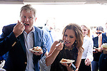 Republican presidential hopeful Michele Bachmann and her husband Marcus Bachmann taste pie at a campaign stop at the Story County Fair on Saturday, July 23, 2011 in Nevada, IA.