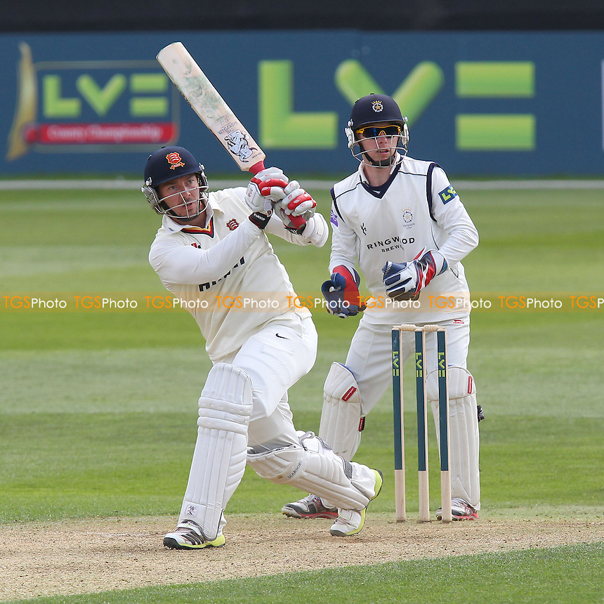 Graham Napier hits four runs for Essex as Adam Wheater looks on - Essex CCC vs Hampshire CCC - LV County Championship Division Two Cricket at the Essex County Ground, Chelmsford - 30/04/13 - MANDATORY CREDIT: Gavin Ellis/TGSPHOTO - Self billing applies where appropriate - 0845 094 6026 - contact@tgsphoto.co.uk - NO UNPAID USE.