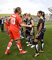 LA Sol's Marta and Washington Freedom's Abby Wambach shake hands before the start of the WPS season opening game at the Home Depot Center, Sunday, March 29, 2009. The LA Sol won 2-0.