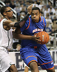 Bishop Gorman's Ronnie Stanley drives past Hug defender Samuel Williams during the NIAA 4A State Basketball Championship game between Bishop Gorman and Hug high schools at Lawlor Events Center, in Reno, Nev, on Friday, Feb. 24, 2012. .Photo by Cathleen Allison