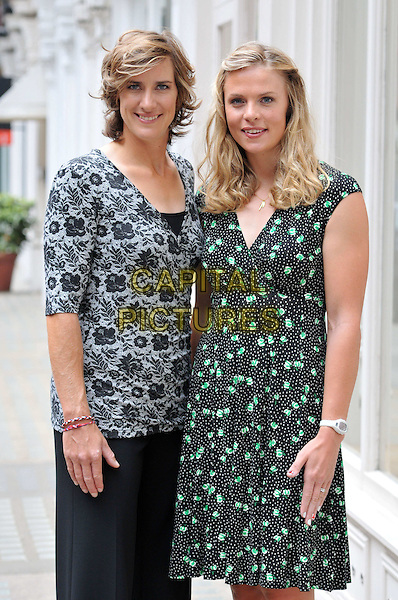 Katherine Grainger & Anna Watkins.Olympic athletes and Long Tall Sally ambassadors attend media day and photocall for fashion brand Long Tall Sally which makes clothes for taller women having launched the LTS Row collection with them, Long Tall Sally, London, England..August 20th, 2012.half length top black grey gray lace trousers green print dress wrap .CAP/BF.©Bob Fidgeon/Capital Pictures.