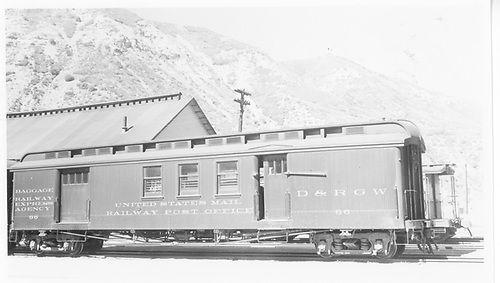 #66 RPO &amp; baggage combine car at Durango.  Side view.  Ice house in background.<br /> D&amp;RGW  Durango, CO  Taken by Maxwell, John W. - 7/1/1941