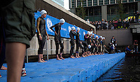 30 JUN 2011 - LONDON, GBR - Competitors wait for the start of the women's super sprint final at the GE Canary Wharf Triathlon .(PHOTO (C) NIGEL FARROW)