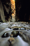 Shallow waters flow through the Virgin River Narrows in Zion National Park, Utah.