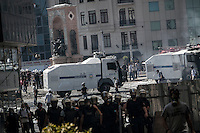 n this Tusday, Jun. 11, 2013 photo, anti-riot policemen advance over streets nearby Taksim Square as they charge against protesters during clashes in Istanbul, Turkey. (Photo/Narciso Contreras).