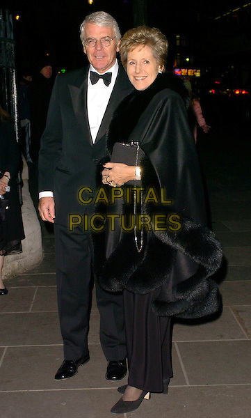 PM JOHN & NORMAN MAJOR.National Portrait Gallery 150th Anniversary Gala at The National Portrait Gallery, London, UK..February 28th, 2006.Ref: CAN.full length black fur coat purse tuxedo.www.capitalpictures.com.sales@capitalpictures.com.©Capital Pictures