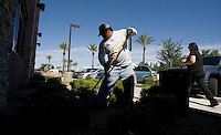 leaving0627 Luis Sanchez, 33, (CQ) of Guerrero, Mexico, (CQ) does landscaping work at an office complex in the West Valley for $9.80 an hour. Sanchez is in the country illegally with his wife and three U.S. born children. (Pat Shannahan/ The Arizona Republic)