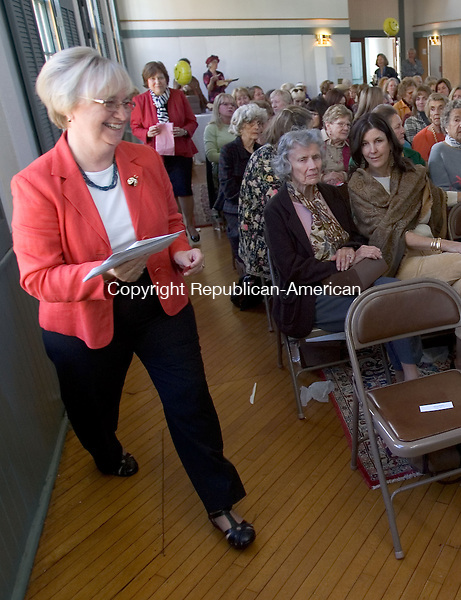 WOODBURY, CT. 16 October 2012-101612SV01-Nancy Bailey of Woodbury hands out the raffle prizes at the Pomperaug Valley Garden Club fundraiser at Woodbury's Old Town Hall in Woodbury Tuesday. .Steven Valenti Republican-American