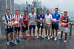 From left to right: Newcastle United's Dan Barlaser, Stoke City's Lewis Banks, Aston Villa's Khalid Abdo, Citi All Stars' Patrik Berger, Hong Kong Football Club's Gary Gheczy, Citi All Stars' Vladimir Smicer, Leicester City's Elliott Moore, and West Ham United's Lewis Page pose for a photograph in front of Hong Kong's urban landscape to celebrate the launch of the HKFC Citi Soccer Sevens on 19 May 2016 in Causeway Bay, Hong Kong, China. Photo by Lucas Schifres / Power Sport Images