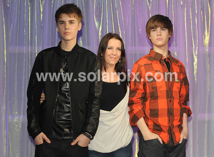 **ALL ROUND PICTURES FROM SOLARPIX.COM**                                             **WORLDWIDE SYNDICATION RIGHTS**                                                                                  Caption:  Justin Bieber meets his new waxwork at Madame Tussauds, London,                                                                             This pic:  Justin Bieber ,his mum & his wax model.   JOB REF: 12976       SSD       DATE: 15.03.2011                                                           **MUST CREDIT SOLARPIX.COM OR DOUBLE FEE WILL BE CHARGED**                                                                      **MUST AGREE FEE BEFORE ONLINE USAGE**                               **CALL US ON: +34 952 811 768 or LOW RATE FROM UK 0844 617 7637**