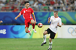 10 August 2008: Zheng Zhi (CHN) (8) plays the ball in front of Sebastien Pocognoli (BEL) (5).  The men's Olympic soccer team of Belgium defeated the men's Olympic soccer team of China 2-0 at Shenyang Olympic Sports Center Wulihe Stadium in Shenyang, China in a Group C round-robin match in the Men's Olympic Football competition.