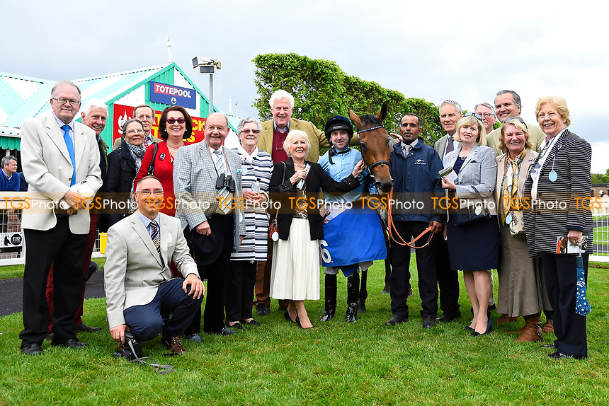 Connections with Jockey Robert Winston and Mam'selle in the Winners enclosure after winning The Smith & Williamson Maiden Fillies' Stakes (Div 2),during Afternoon Racing at Salisbury Racecourse on 18th May 2017