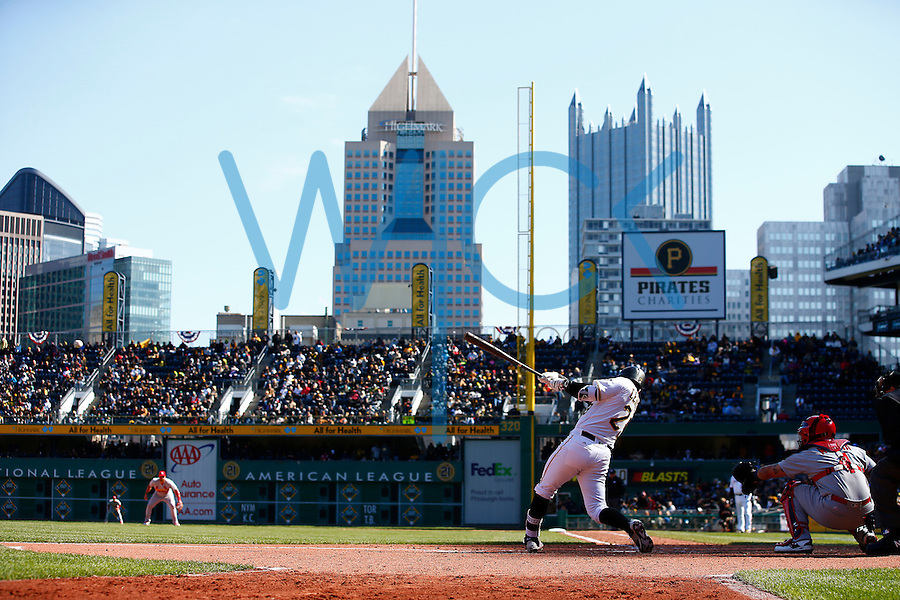 Francisco Cervelli #29 of the Pittsburgh Pirates hits a single in the 8th inning against the St. Louis Cardinals during the Opening Day game at PNC Park in Pittsburgh, Pennsylvania on April 3, 2016. (Photo by Jared Wickerham / DKPS)