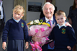 Aoife Grogan and Robert McCabe present the President of Glen Dimplex, Martin Naughton, with a bouquet of flowers at the official opening of the new school extension at Scoil Bhride Dunleer. Photo:  Andy Spearman.