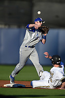 Indiana State Sycamores infielder Derek Hannahs (5) throws to first as Bryan Reynolds (20) slides in during a game against the Vanderbilt Commodores on February 20, 2015 at Charlotte Sports Park in Port Charlotte, Florida.  Vanderbilt defeated Indiana State 3-2.  (Mike Janes/Four Seam Images)