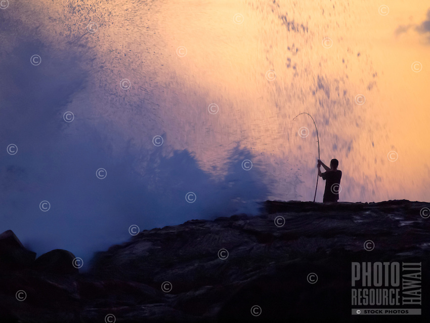 At sunset, a fisherman gets deluged by high surf at Keahole Point, Kona Coast, Island of Hawai'i.