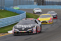Aug. 8, 2009; Watkins Glen, NY, USA; NASCAR Nationwide Series driver Jason Leffler (38) leads Jason Keller (27) during the Zippo 200 at Watkins Glen International. Mandatory Credit: Mark J. Rebilas-