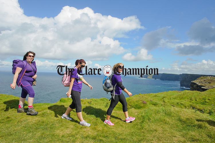 Anna O Doherty, Aoife Meehan and Sarah Ryan put their best foot forward at hags Head during the Weightwatchers/Clare Champion Liscannor to Cliffs of Moher coastal walk. Photograph by John Kelly.