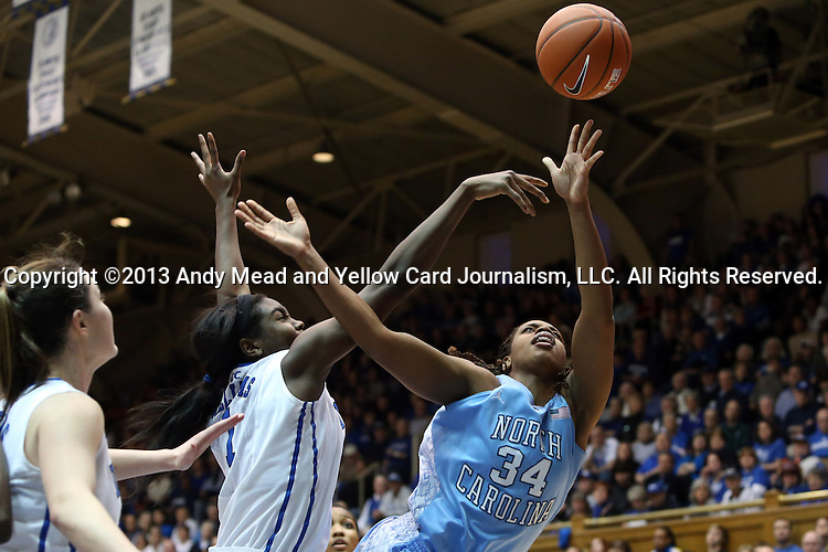 03 March 2013: North Carolina's Xylina McDaniel (34) has a shot blocked by Duke's Elizabeth Williams (1). The Duke University Blue Devils played the University of North Carolina Tar Heels at Cameron Indoor Stadium in Durham, North Carolina in a 2012-2013 NCAA Division I and Atlantic Coast Conference women's college basketball game. Duke won the game 65-58.